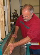 Michael Schuler working on the industrial planer